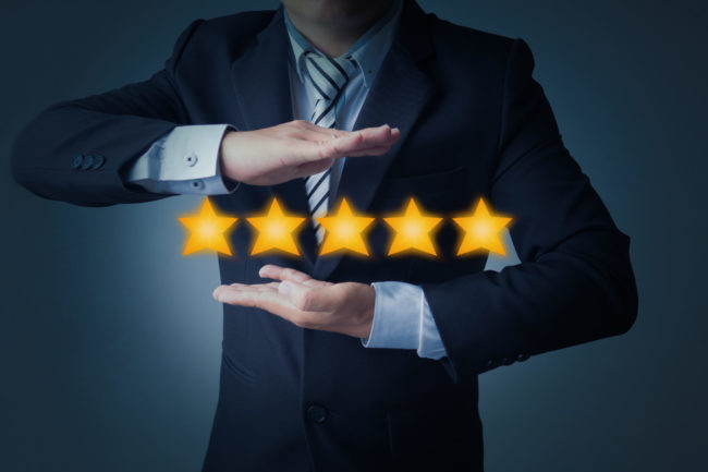 excellent service and best customer experience or good client , business man showing 5 stars rating on dark blue background